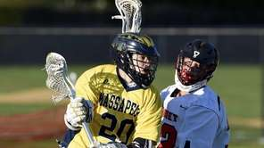 Massapequa attacker Carter Hawthorne is defended by Syosset