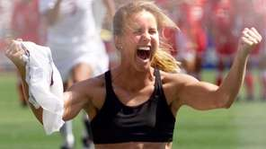 USA's Brandi Chastain shouts after scoring the game-winning