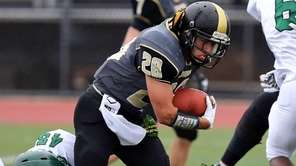 Commack RB Jordan Levine can't break the grip