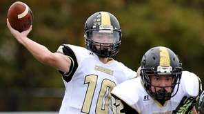 Commack QB Ryan Sheridan throws a touchdown pass