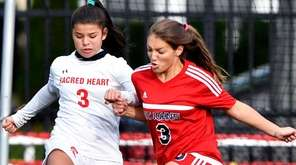 Victoria Minda, left, of Sacred Heart gets by