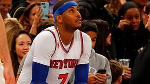 Carmelo Anthony of the New York Knicks sits