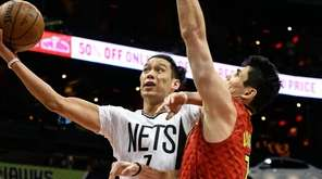 Brooklyn Nets guard Jeremy Lin, left, shoots as