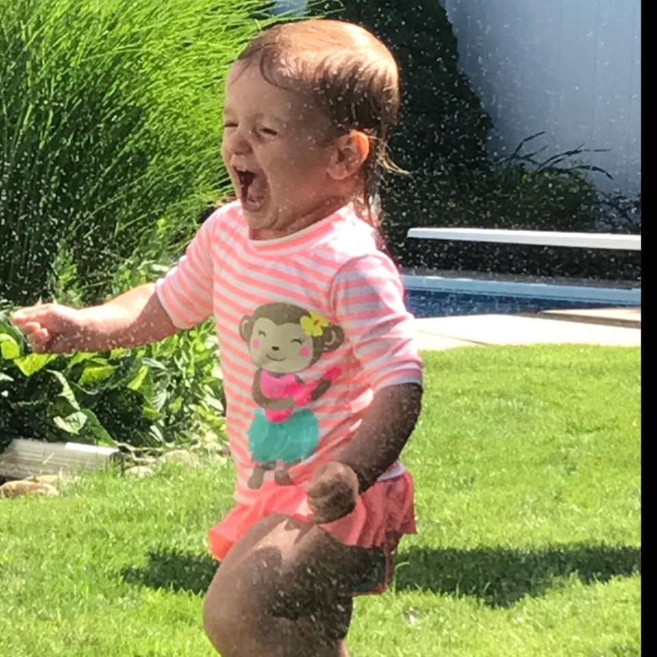 Brooklyn's 1st time running through a lawn sprinkler!