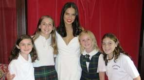 Adriana Lima with Kidsday reporters from left, Christina