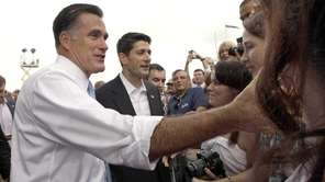 Republican presidential candidate Mitt Romney, left, and vice