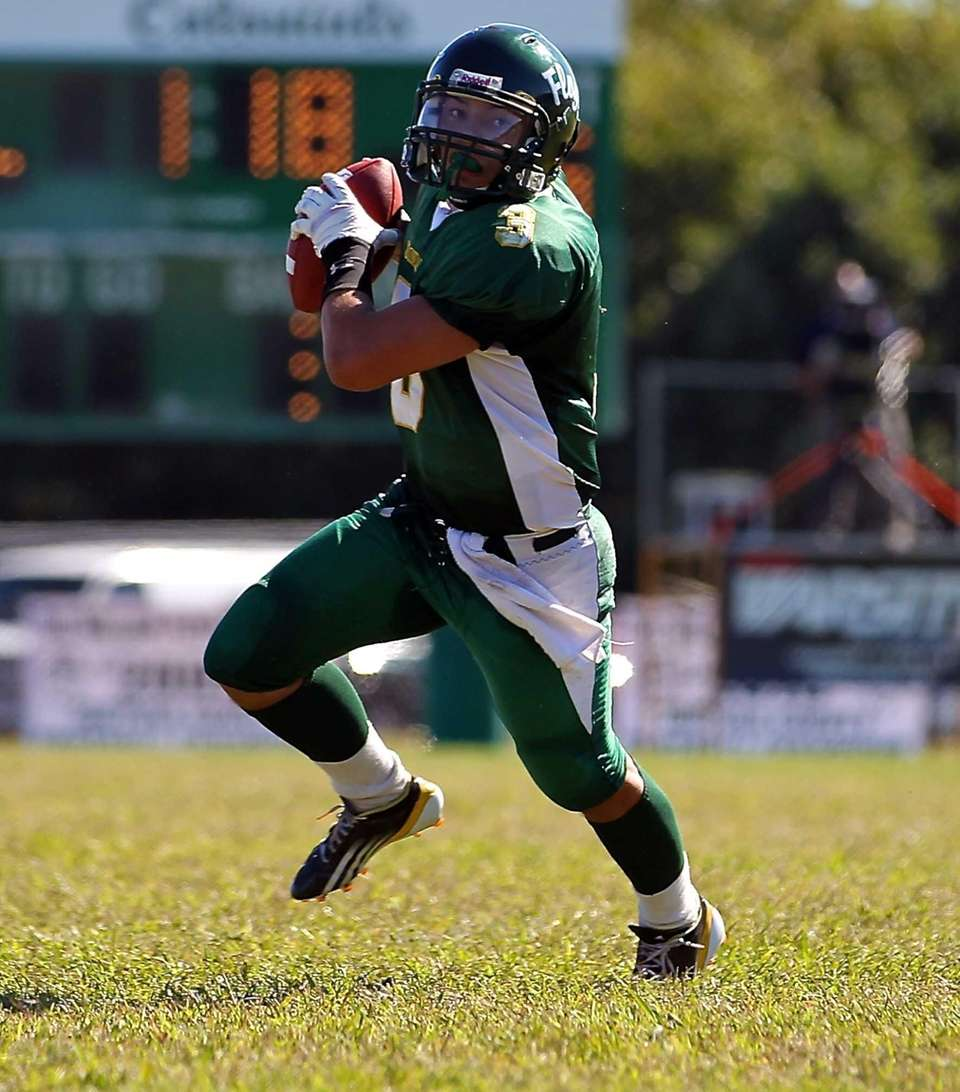 William Floyd quarterback A.J. Otranto scrambles out of