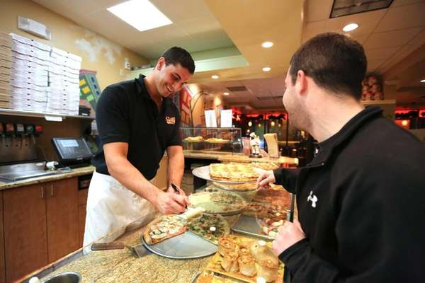 SaVino's co-owner Mike Biancaniello at the pizza counter.