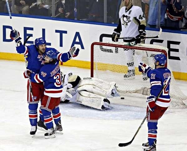 Rangers right wing Ryane Clowe celebrates with Rangers