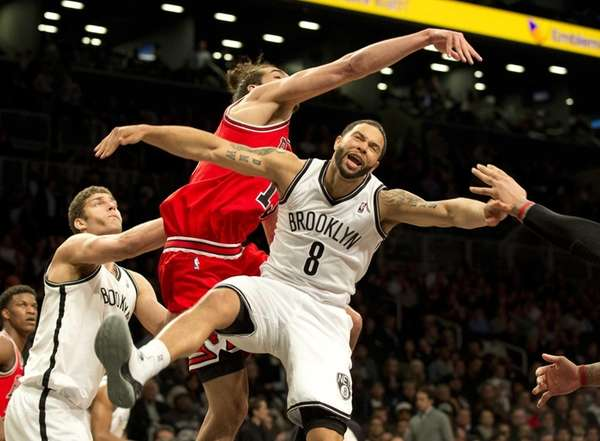 Chicago Bulls center Joakim Noah slaps the ball