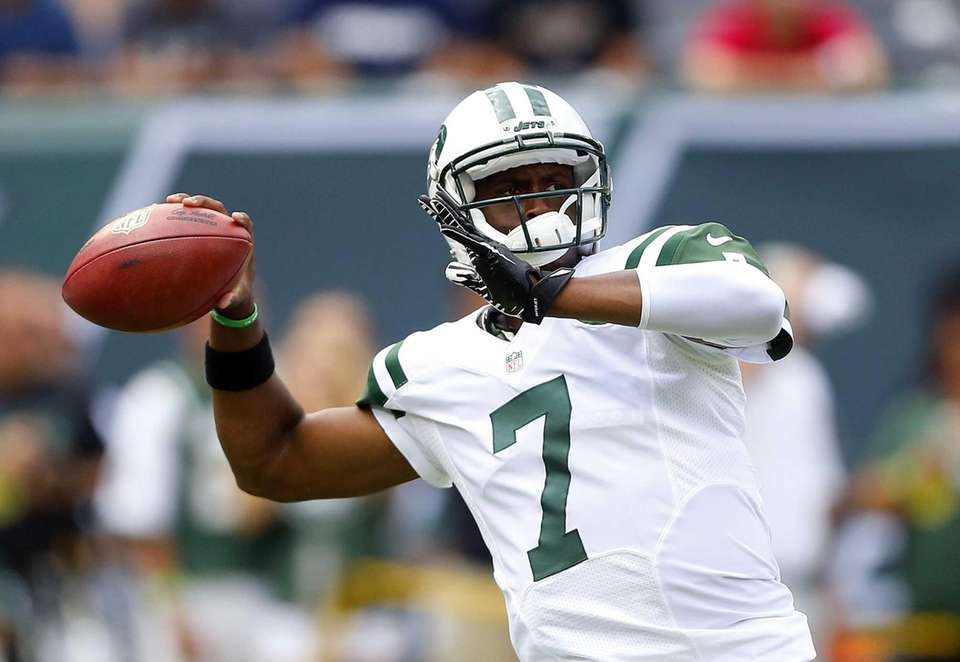 Geno Smith warms up before a game against