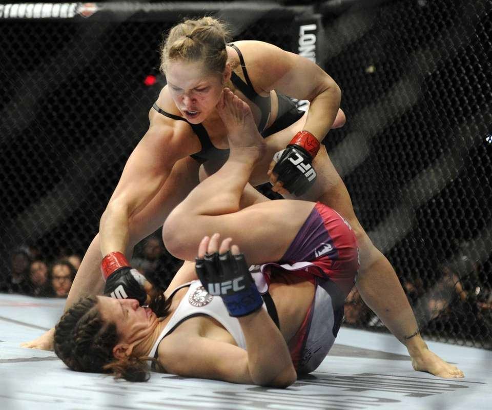 Ronda Rousey punches Miesha Tate during the UFC
