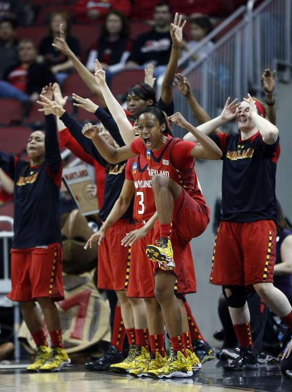 Maryland guard Shatori Walker-Kimbrough and the bench reacts
