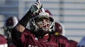 Garden City's Brian Haeffner points skyward after rushing