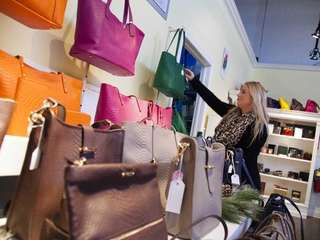 Michelle Breitstein of Syosset shops for GiGi handbags