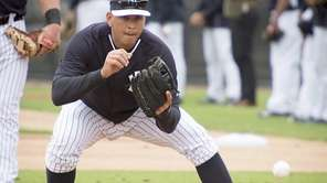 Yankees third baseman Alex Rodriguez takes part in