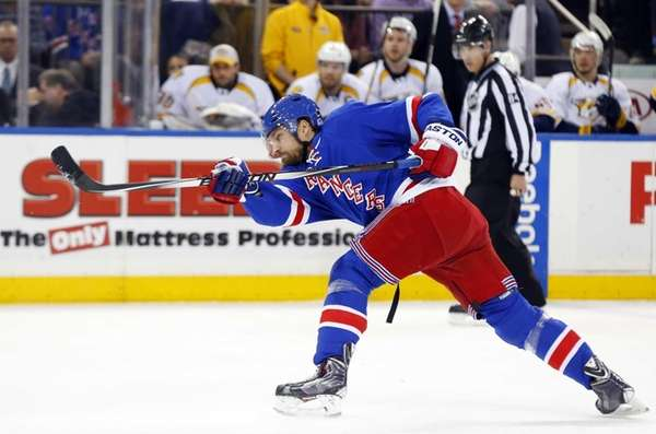 Kevin Klein of the Rangers shoots the puck