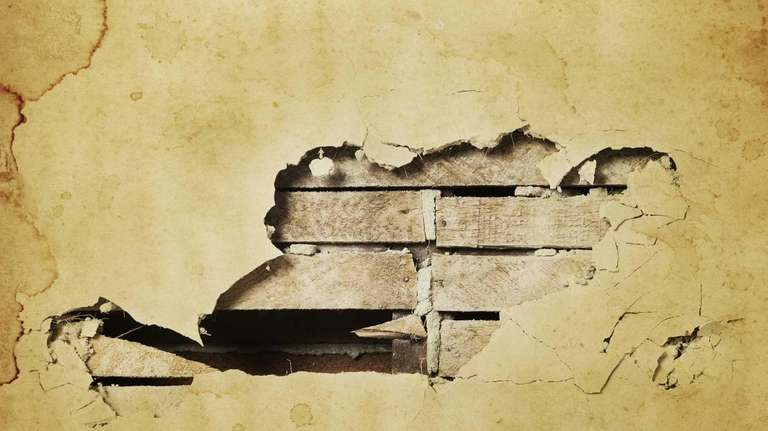 A Grungy Wall With Hole In