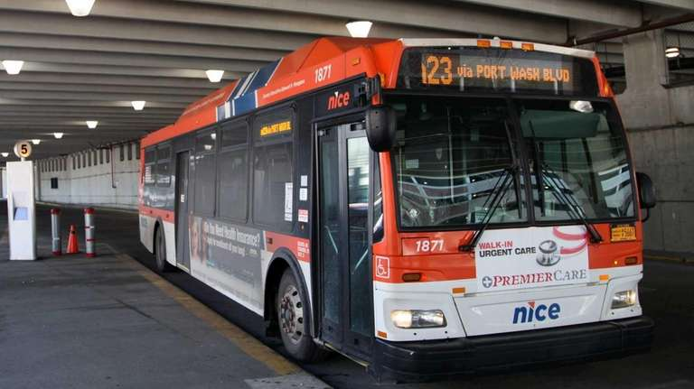 A NICE bus stops at the Mineola Intermodal