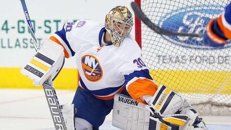 Michal Neuvirth of the New York Islanders skates