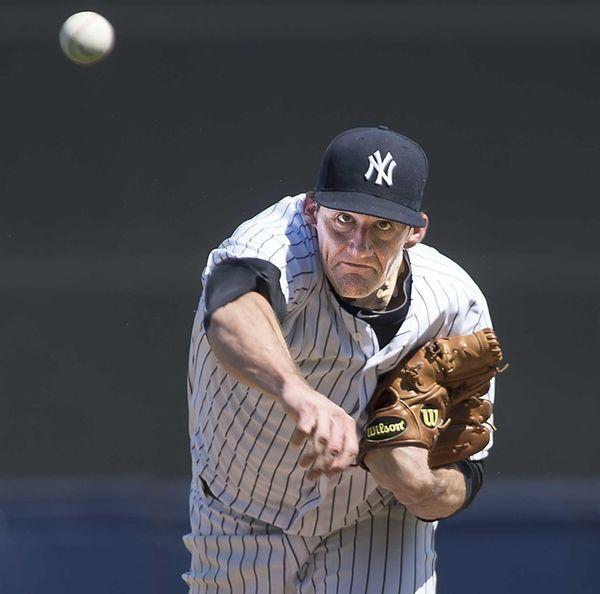 New York Yankees starting pitcher Nathan Eovaldi warms