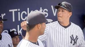 New York Yankees' Alex Rodriguez greets his teammates