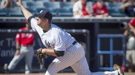 New York Yankees pitcher Kyle Davies delivers a