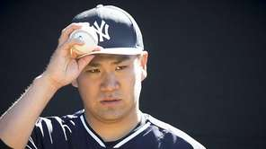New York Yankees pitcher Masahiro Tanaka throws in