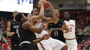 Stony Brook Seawolves guard Carson Puriefoy is defended