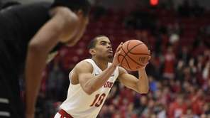 Stony Brook guard Carson Puriefoy shoots a free