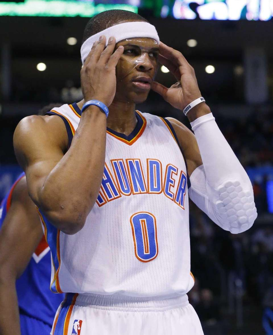 Oklahoma City Thunder guard Russell Westbrook adjusts his