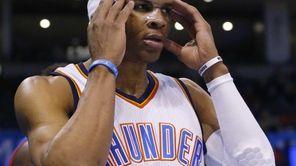 Oklahoma City Thunder guard Russell Westbrook adjusts his