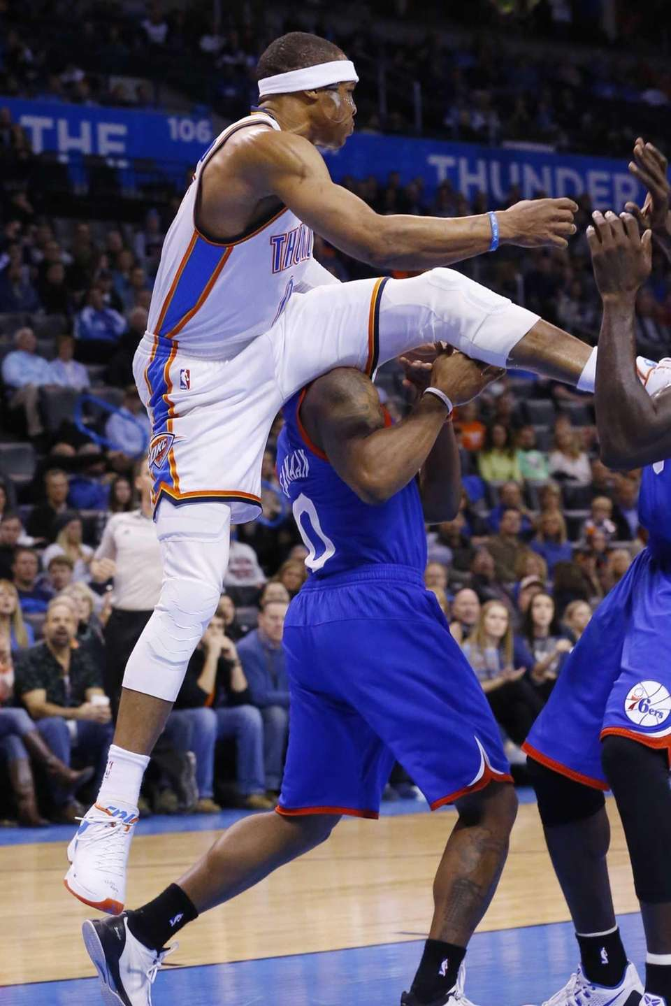 Oklahoma City Thunder guard Russell Westbrook, left, comes