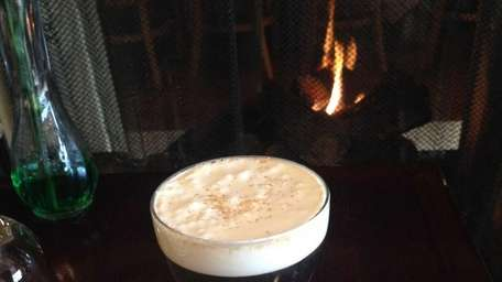 Irish coffee, served fireside, at Flanagan's Pub in
