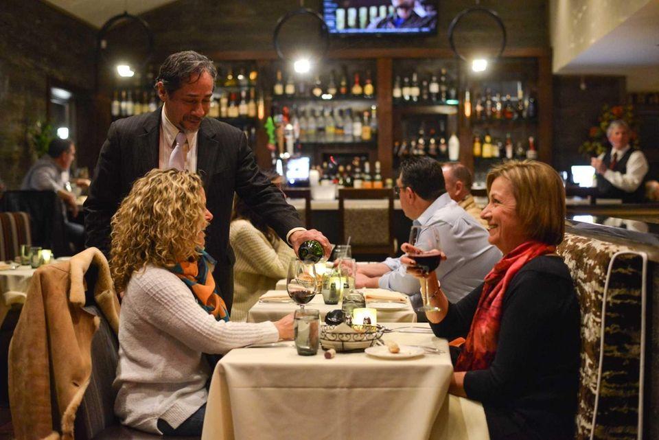 General Manager Armando Escobedo Pours Wine For Debbie