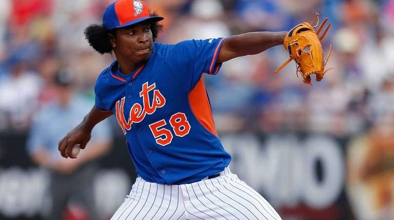 Jenrry Mejia pitches during a game against the