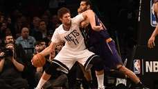 Brooklyn Nets' Brook Lopez drives against the Phoenix