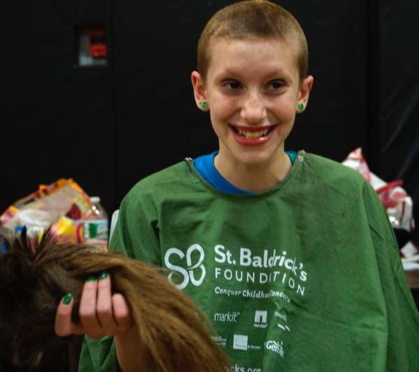 Madison Adelman, 11, had her head shaved in
