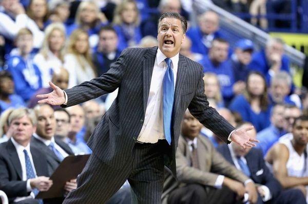 Kentucky head coach John Calipari gives instructions to