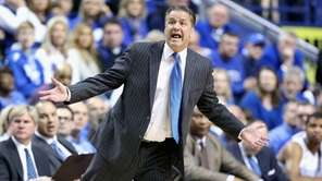 Kentucky head coach John Calipari gives instructions to