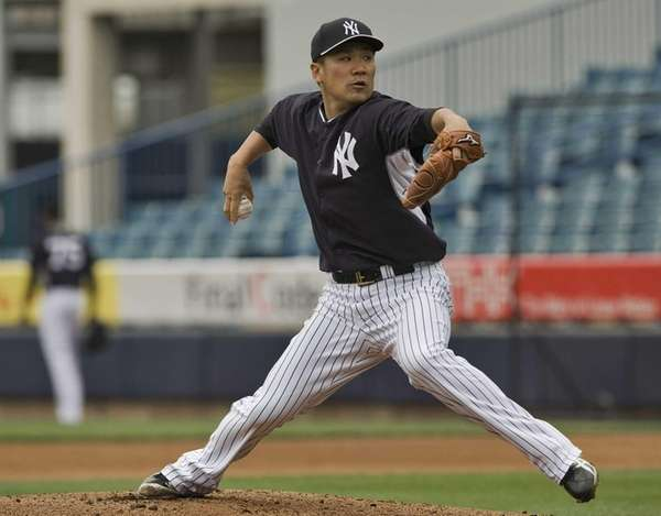 New York Yankees pitcher Masahiro Tanaka throws during