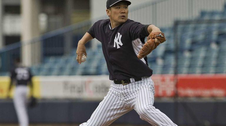 New York Yankees pitcher Masahiro Tanaka throws during