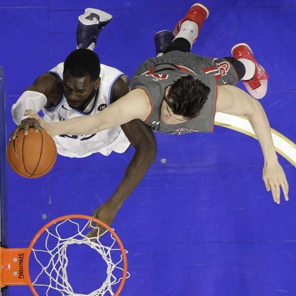 Villanova's Daniel Ochefu, left, goes up for a