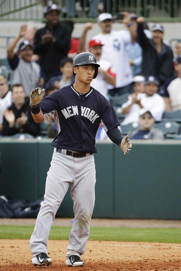 New York Yankees' Robert Refsnyder claps his hands