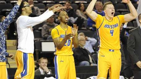 From left, Hoftra's Andre Walker, Jamall Robinson and