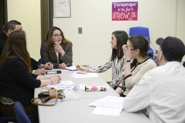 Principal Denise Stevenson, center, speaks with teachers and