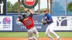 Mets shortstop Wilmer Flores throws to first base