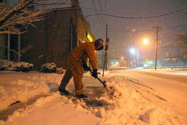 Kevin Nicoll shovels his walkway on Willis Avenue
