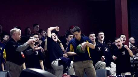 East Islip's boys bowling team reacts to a
