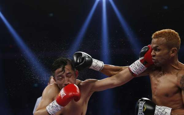 China's double Olympic gold medalist Zou Shiming, left,